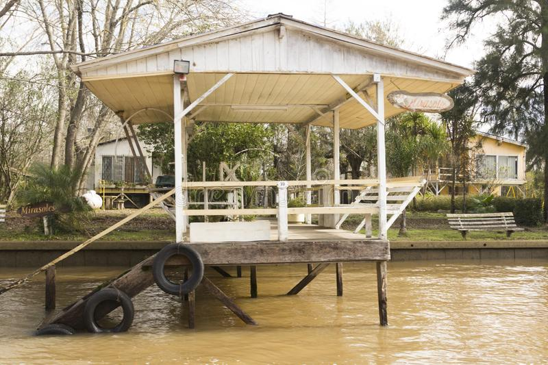 Wooden dock seen from boat in the Delta del Parana, Tigre Buenos Aires Argentina.  royalty free stock image