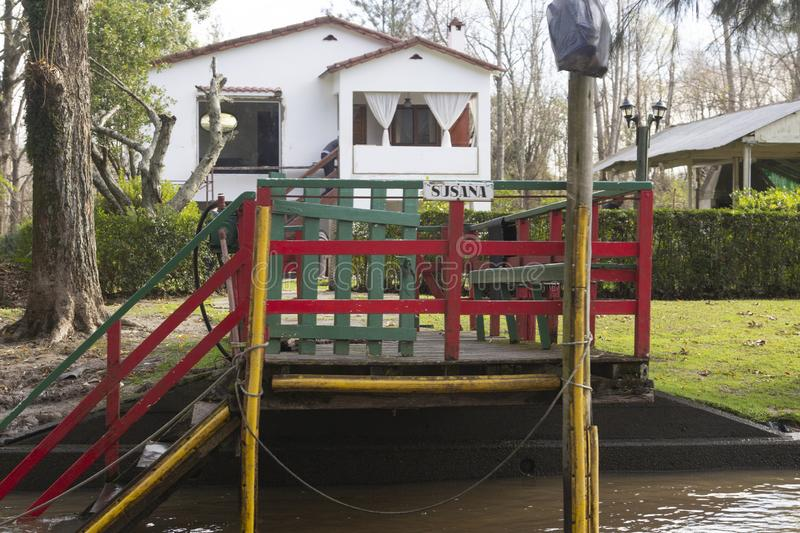 Wooden dock seen from boat in the Delta del Parana, Tigre Buenos Aires Argentina.  stock photography