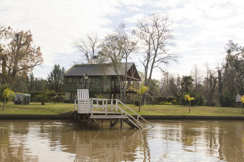 Wooden dock seen from boat in the Delta del Parana, Tigre Buenos Aires Argentina.  stock image