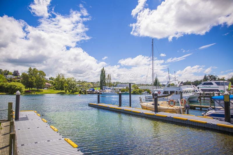 Wooden Dock Under Blue and White Sunny Cloudy Sky royalty free stock photography