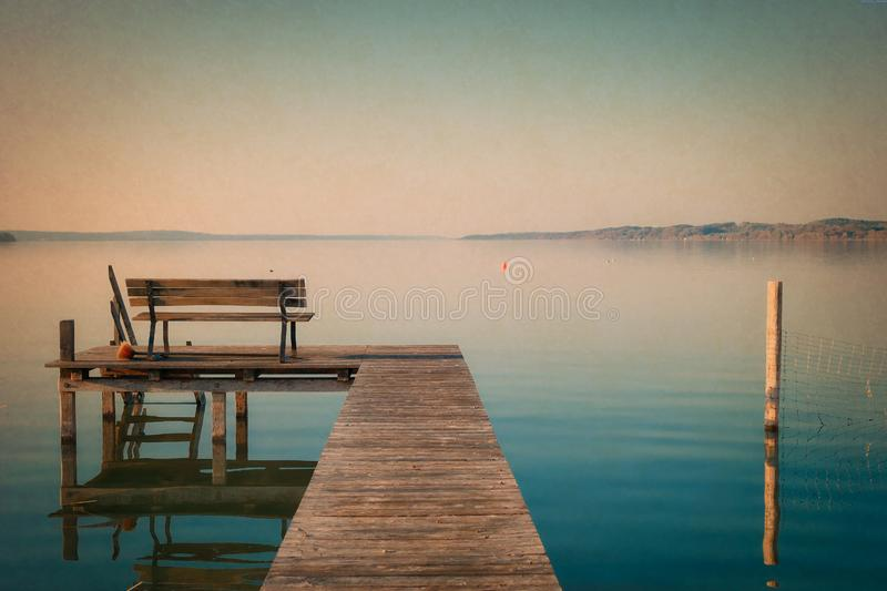 Wooden dock on waterfront stock photography