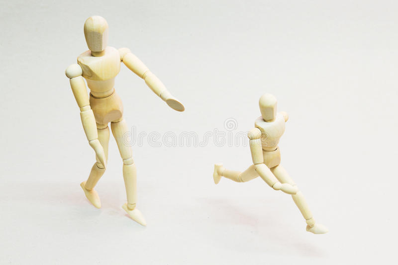 Wooden Doll in Action stock photography