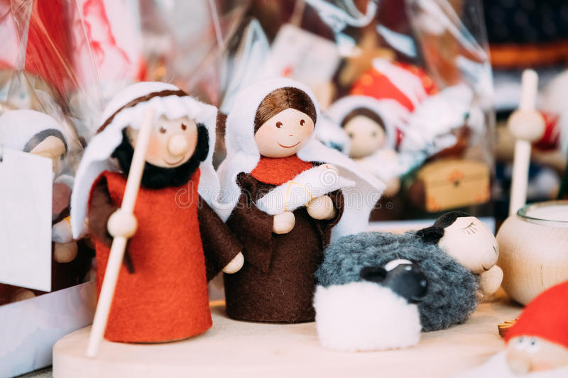 Wooden Dolls Birth of Jesus At Christmas European Market. Popular Christmas Souvenir. Wooden Dolls Toys Birth of Jesus At Christmas European Market. Popular stock images