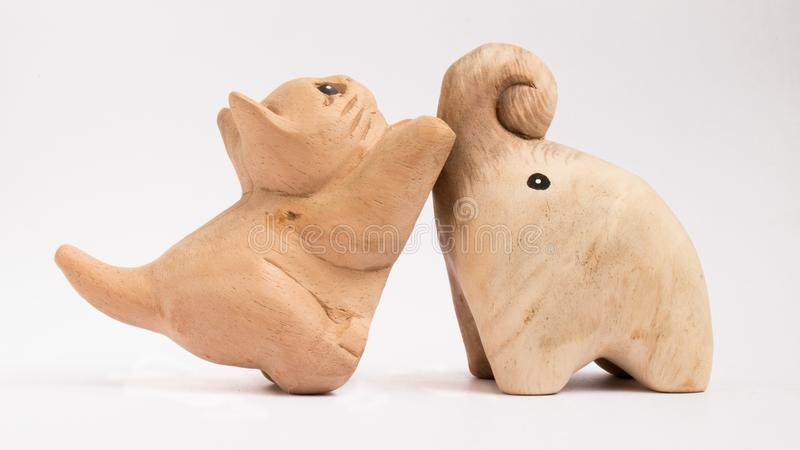 The Wooden Dolls. Cat and Elephant wooden toy dolls stock image