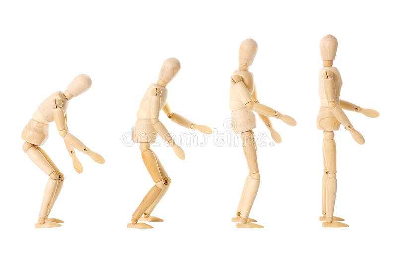 Wooden dolls with different postures. Four wooden dolls with different postures over a white background stock image