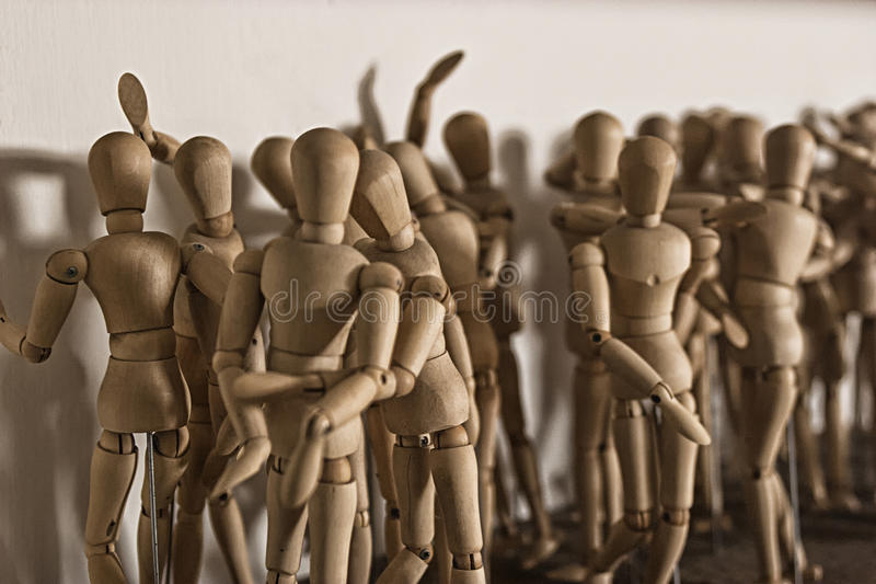 Wooden dolls for drawing. Crowd of wooden dolls for drawing royalty free stock images