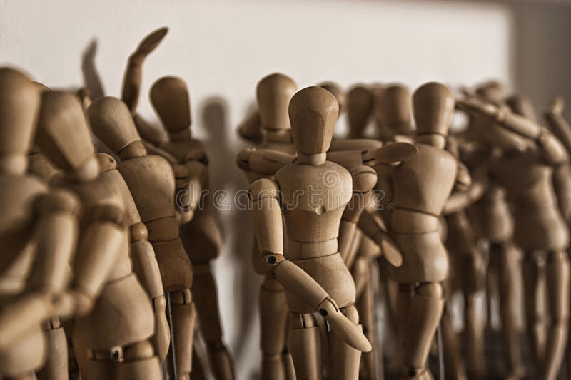 Wooden dolls for drawing. Crowd of wooden dolls for drawing stock photo