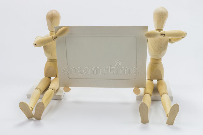 Wooden dolls. With empty background royalty free stock photos