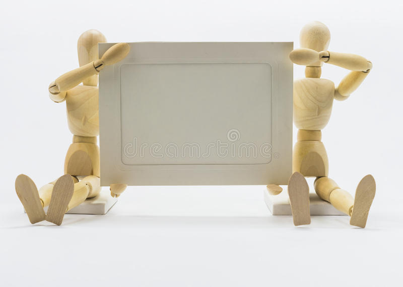 Wooden dolls. With empty background stock photography