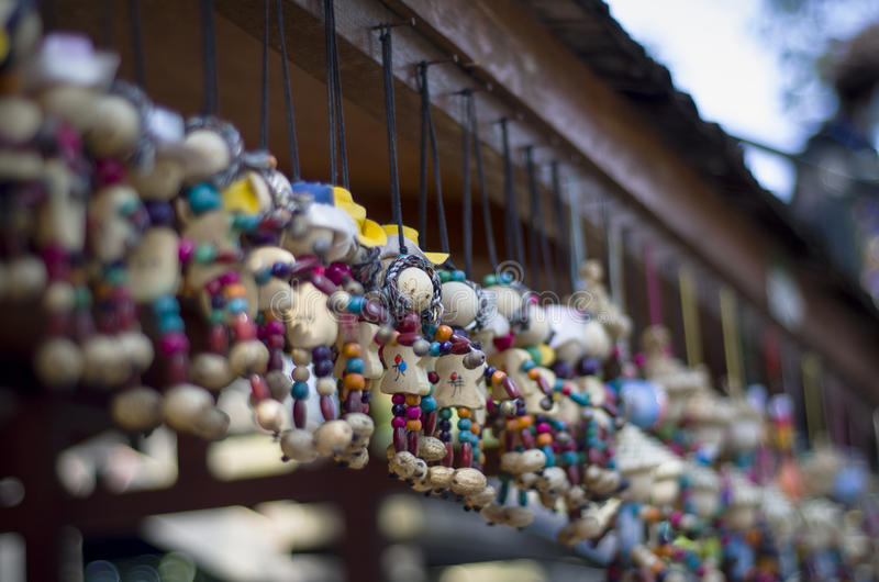 Wooden dolls hang in line royalty free stock image