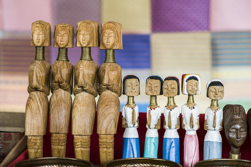 Wooden Dolls of Karen long neck hill tribe. The village in north of Thailand, acting as welcome to visit stock images