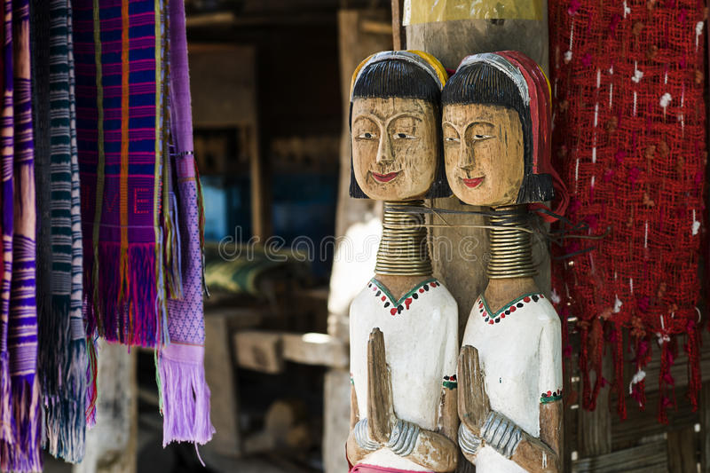 Wooden Dolls of Karen long neck hill tribe. The village in north of Thailand, acting as welcome to visit royalty free stock photo