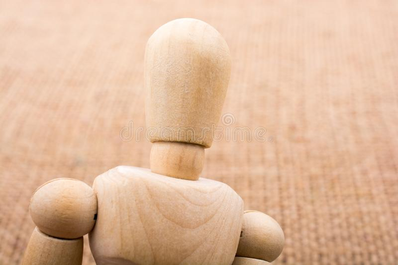 Wooden dolls posing on canvas. Wooden dolls of a man posing on canvas stock photos