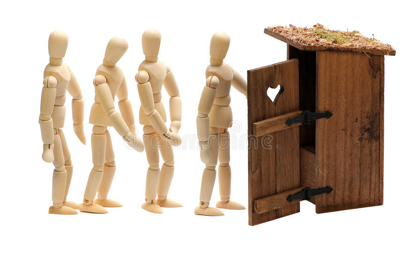 Wooden dolls in waiting line stock photography