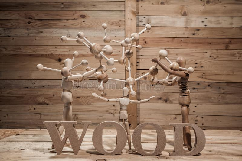 Wooden dolls with wood text on wood table. In wood scene royalty free stock photos