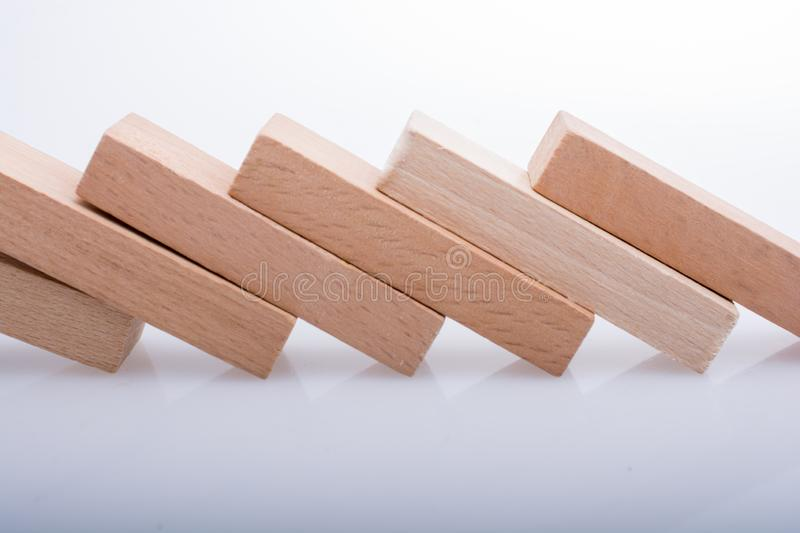 Wooden domino blocks on white background. Wooden Domino Blocks in a line on a white background stock photos