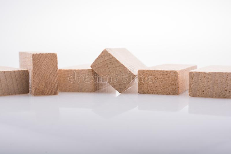 Wooden domino blocks on white background. Wooden Domino Blocks in a line on a white background royalty free stock photos