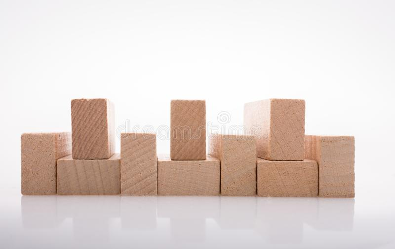 Wooden domino blocks on white background. Wooden Domino Blocks in a line on a white background stock image