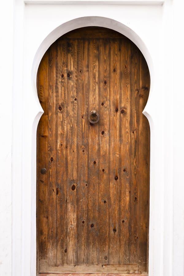 Wooden door. Traditional Moorish style wooden door in a white background stock image