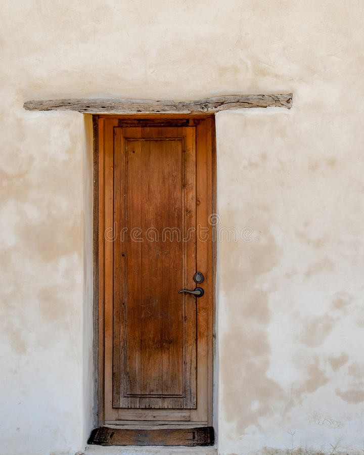 Free Wooden Door Against White Washed Plaster Wall Stock Photography - 62375372