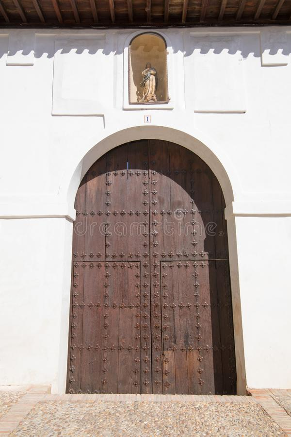 Wooden door of ancient building in Toledo city royalty free stock image