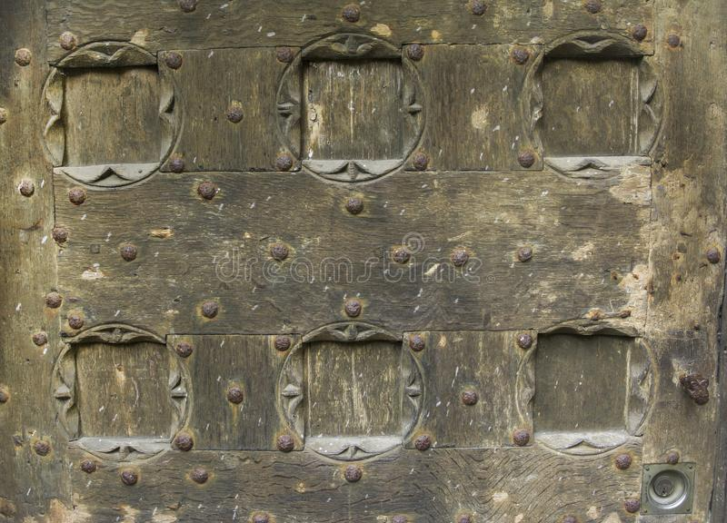 Wooden door with ancient square patten royalty free stock image