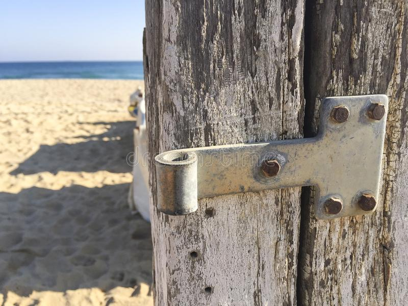 Wooden door on the beach royalty free stock image