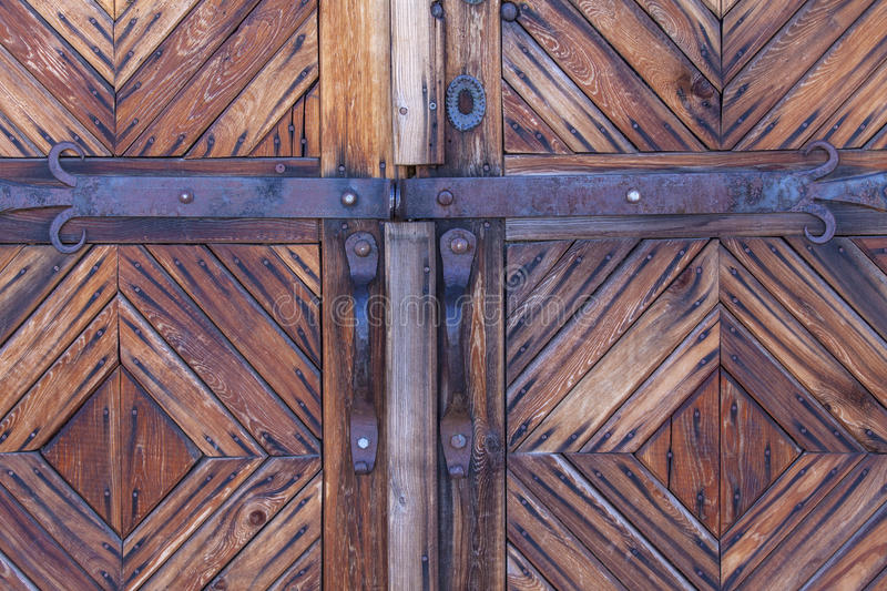 Wooden door with bolt. On Kamchatka stock images