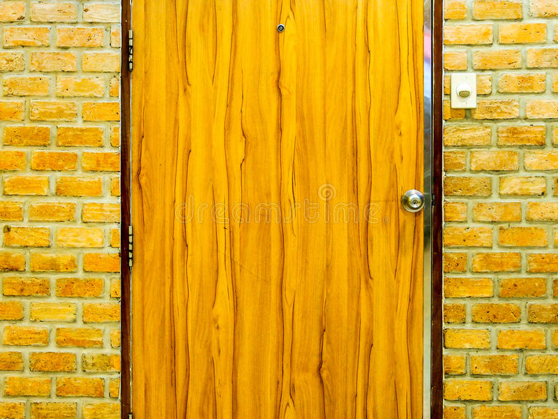 Wooden door and Brick wall royalty free stock image