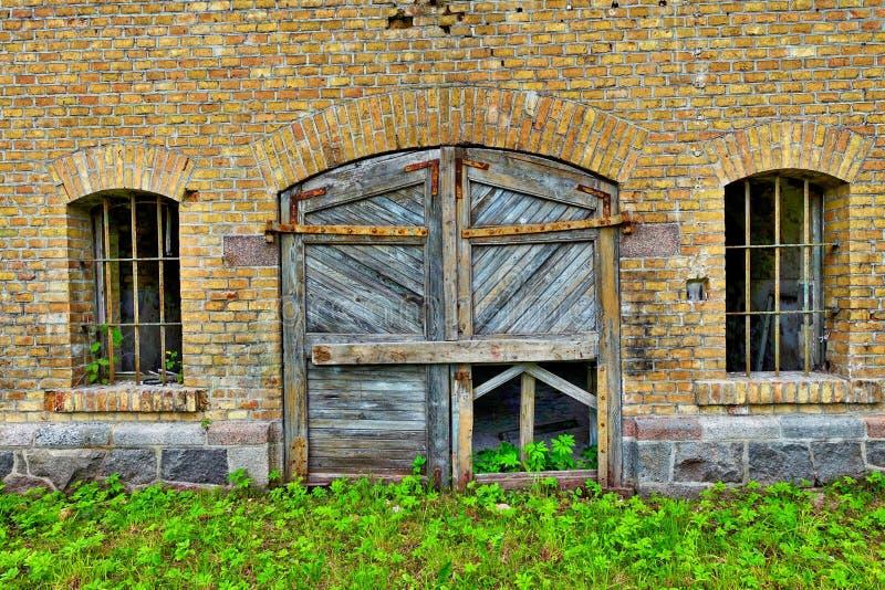 Wooden door in brick wall stock photo