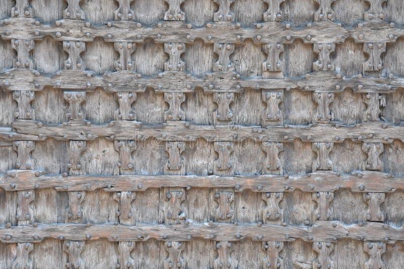 Wooden door in church Sant'Anastasia in Verona stock photography