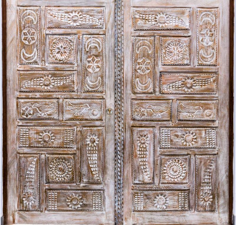 Wooden door detail. Carved wooden door detail texture stock image