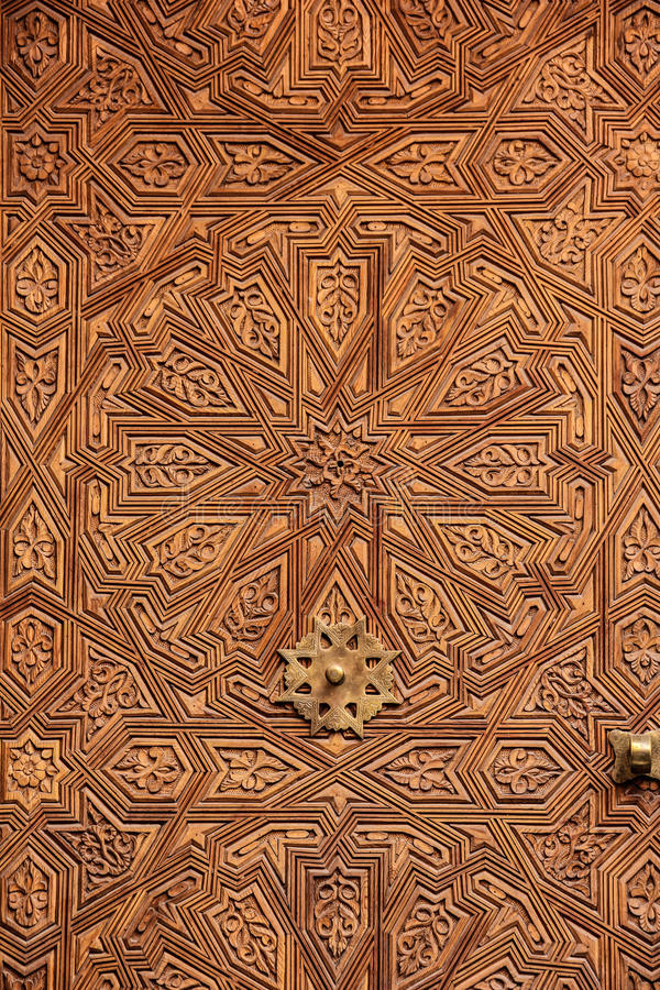 Wooden door. Detail. Marrakesh . Morocco. Wooden door. Geometric pattern. Marrakesh . Morocco stock image