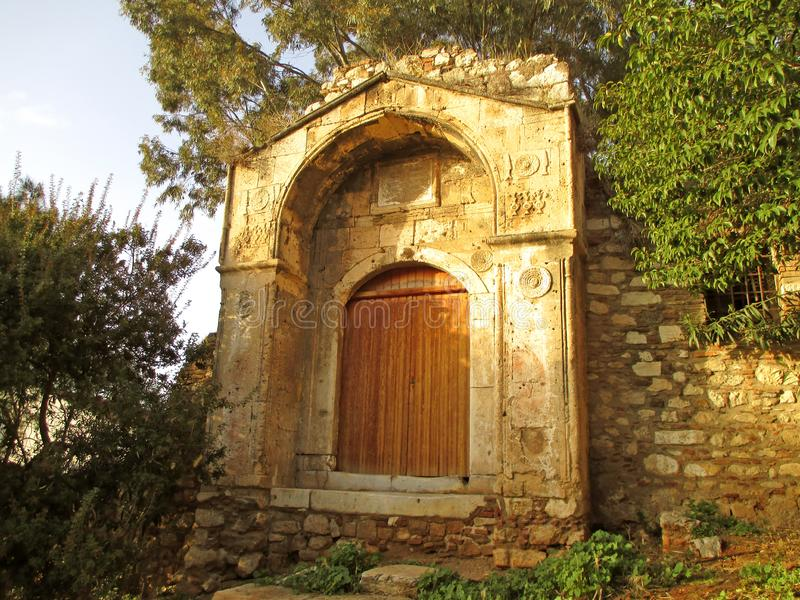 Wooden Door on the Facade of Vintage Stone Building in Plaka Historic Neighborhood of Athens, Greece. South America stock photos