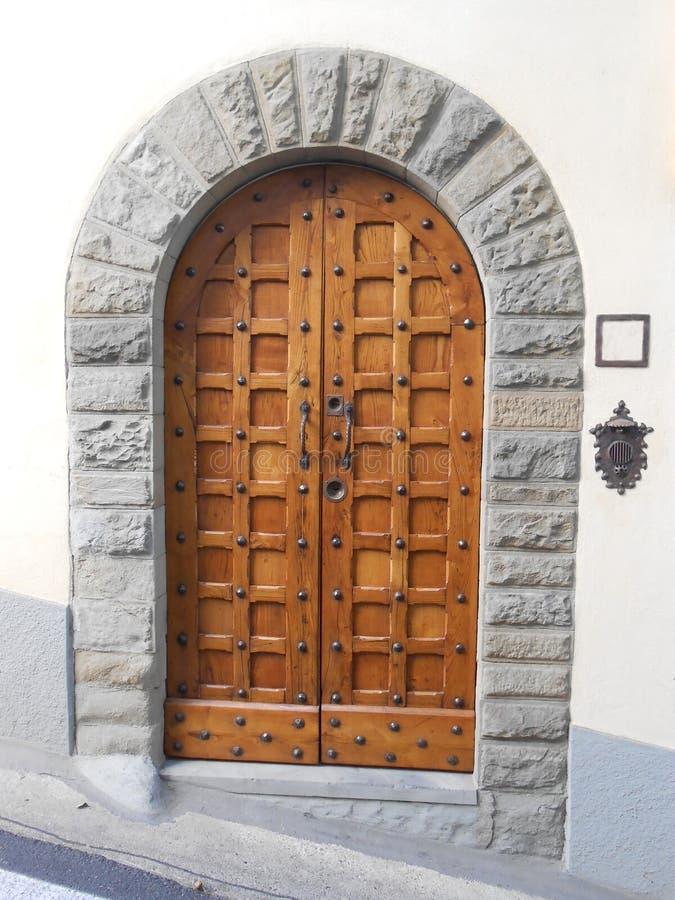 WOODEN DOOR, FIESOLE, ITALY. Wooden elegant door in a street of Fiesole, Tuscany, Italy royalty free stock photos