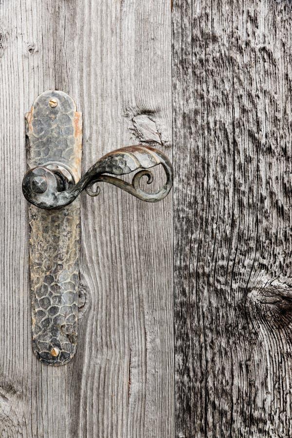Wooden door with iron handle. stock photos