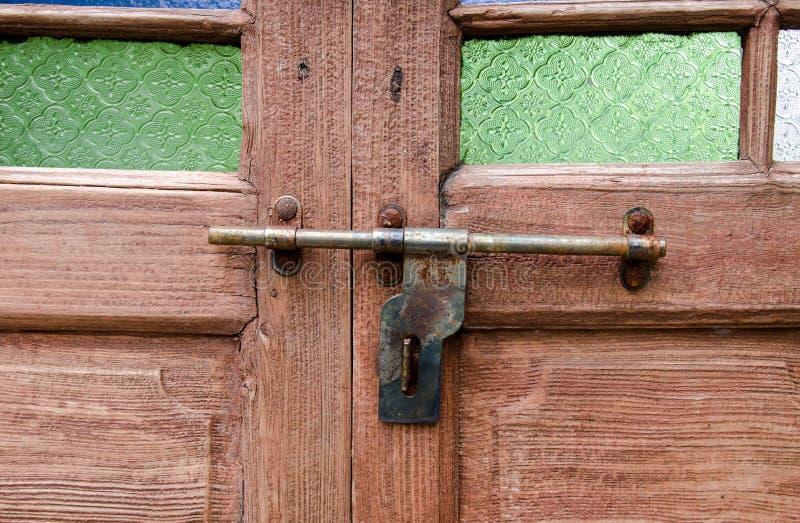 Wooden door with lock stock photography