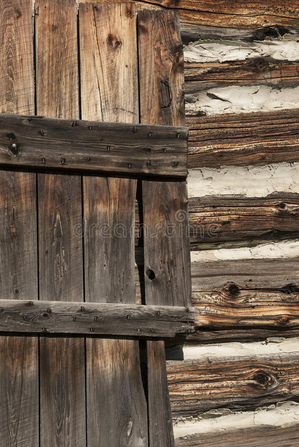 Wooden Door and Logs Cabin Wall royalty free stock images