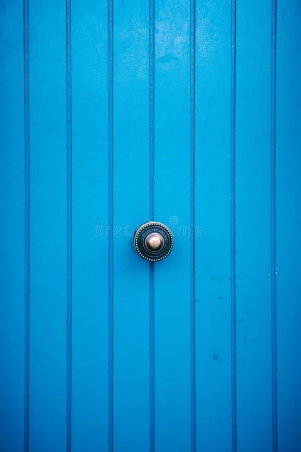 Wooden door with metal handle royalty free stock image