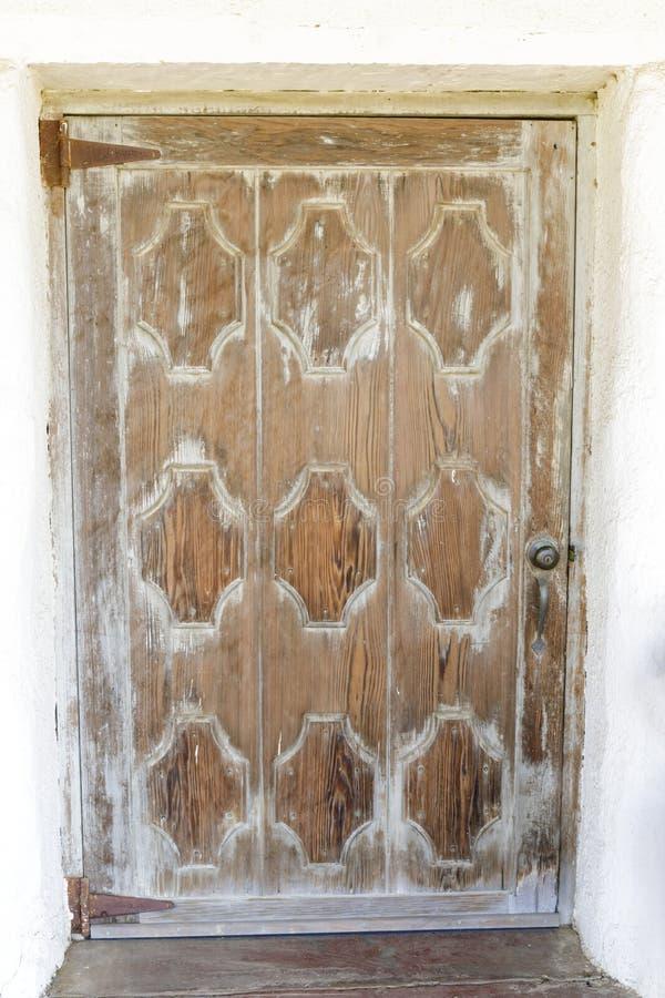 Wooden door at Mission Soledad royalty free stock photos