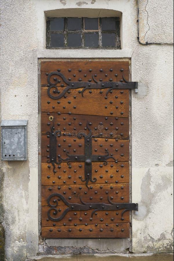 Door antique wood mailbox window. Wooden door old and dark wooden and window with metal mailbox on a house royalty free stock image