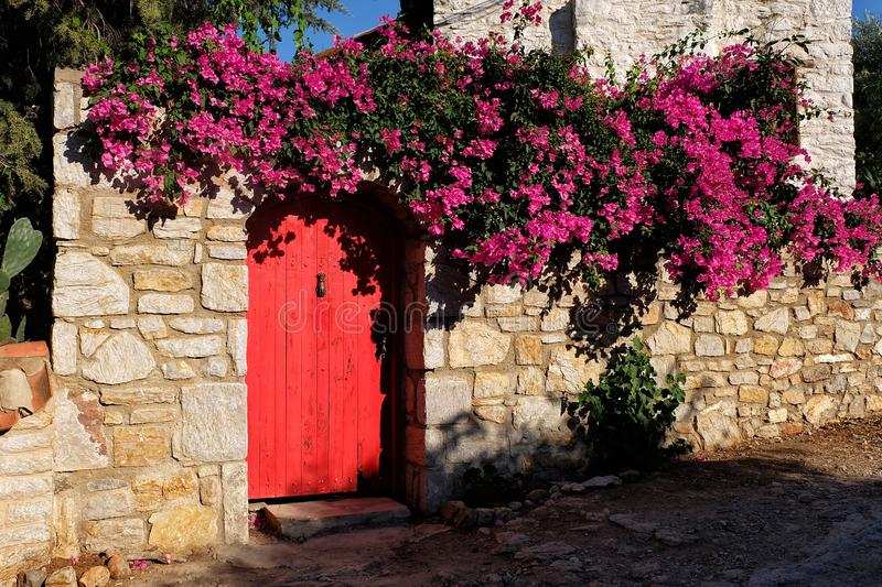 Wooden door in old Datca, Mugla, Turkey. Old Datca with beautiful old stone houses in Mugla, Turkey royalty free stock photos