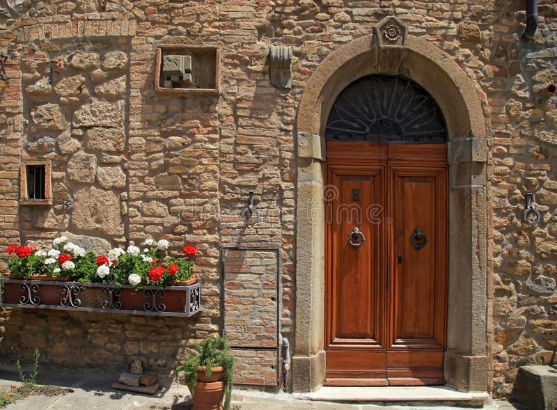Wooden door in old Italian house, Tuscany, Italy stock photos