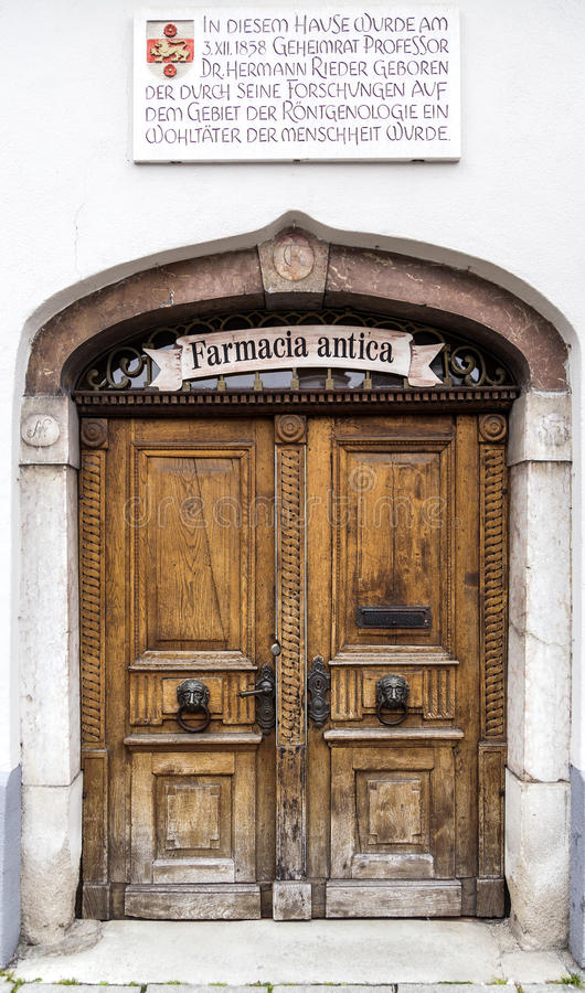 Wooden Door of Pharmacy Shop. Old brown wooden door of a vintage pharmacy shop in Rosenheim, Germany stock photo