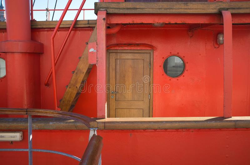 Wooden door of a red sailing ship during daytime in Dunkerque, France royalty free stock photography