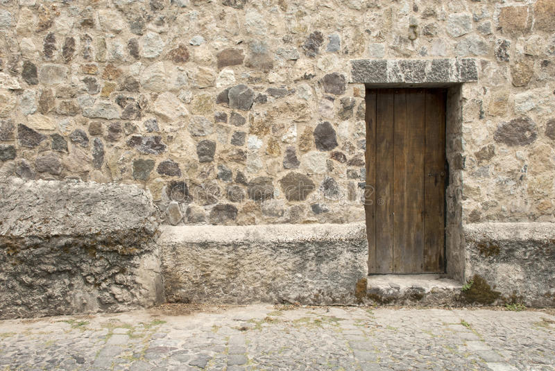 Download Wooden Door And Stone Wall stock image. Image of door - 49277503