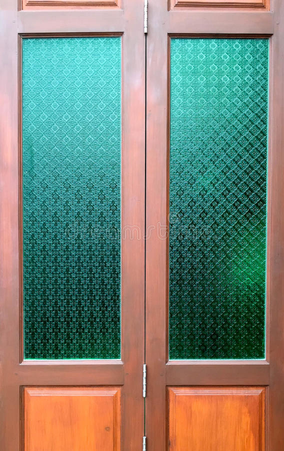 Wooden door with Thai culture Glass in classic style stock images