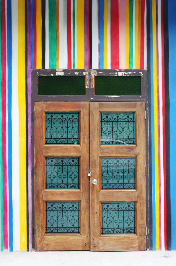 Wooden door on wall royalty free stock photography