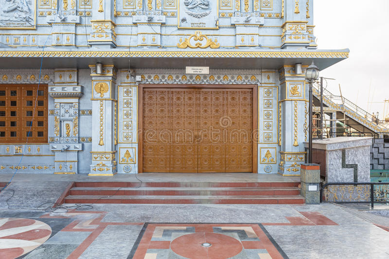 Wooden door and wall detail of Temple of Lord Shiva at Siddhesvara Dhaam in Namchi. Sikkim, India stock photography