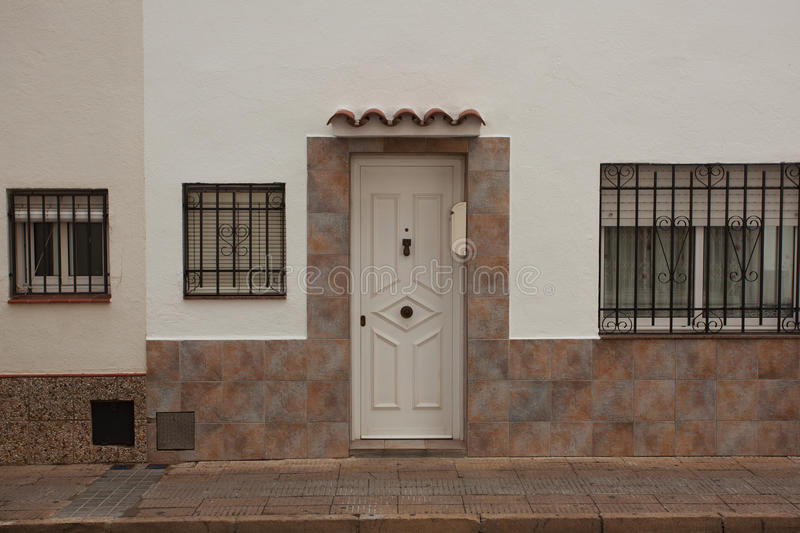 Wooden door in a white stucco house royalty free stock photos
